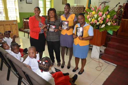 Dionne Lewis (left) from the APlus Academy of Excellence and two assistant teachers with pupils from the school