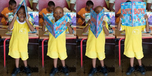 The joy of books: a young pupil at Nannyville Basic School explores one of the books