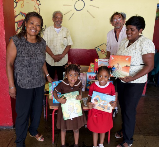 Delivering the books to Nannyville Basic School with (at the back) Ivan Coore and George O'Connor who helped with transport and (on the right) Nicole Sterling, Principal at the school